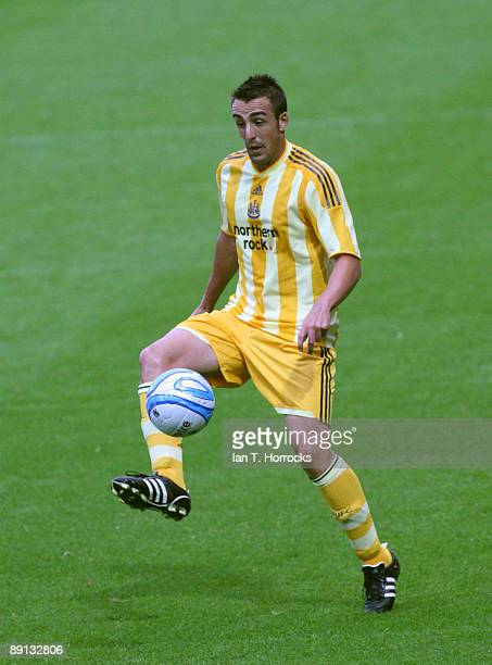 Jose Enrique in action during a preseason friendly match between Huddersfield Town and Newcastle United at the Galpharm Stadium on July 21 2009 in...