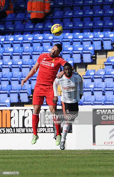 Jose Enrique of Liverpool and Larnell Cole of Fulham in action during the U21 Premier League game between Liverpool and Fulham at The Swansway...