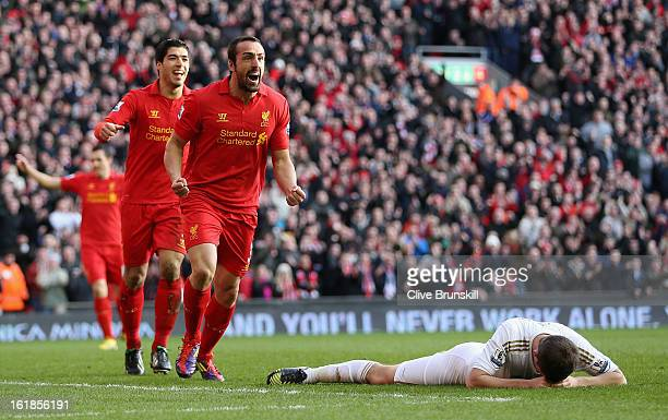 Jose Enrique of Liverpool celebrates after scoring the third goal during the Barclays Premier League match between Liverpool and Swansea City at...
