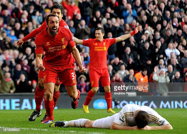 Jose Enrique of Liverpool celebrates his goal during the Barclays Premier League match between Liverpool and Swansea City at Anfield on February 17,...