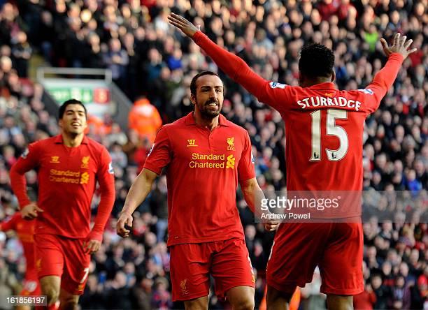 Jose Enrique of Liverpool celebrates his goal with Luis Suarez and Daniel Sturridge during the Barclays Premier League match between Liverpool and...