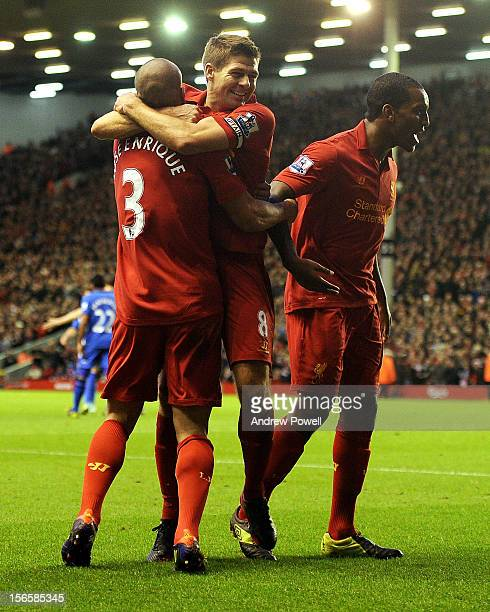 Jose Enrique of Liverpool celebrates his goal with Steven Gerrard during the Barclays Premier League match between Liverpool and Wigan Athletic at...