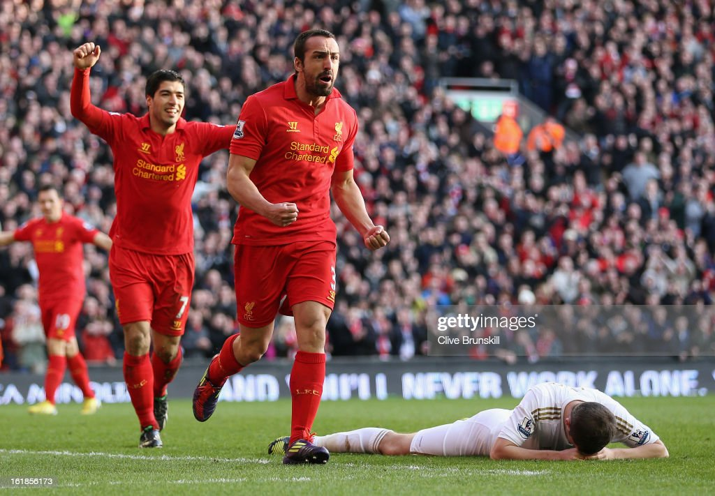 Jose Enrique of Liverpool celebrates with Luis Suarez after scoring the third goal during the Barclays Premier League match between Liverpool and Swansea City at Anfield on February 17, 2013 in Liverpool, England.