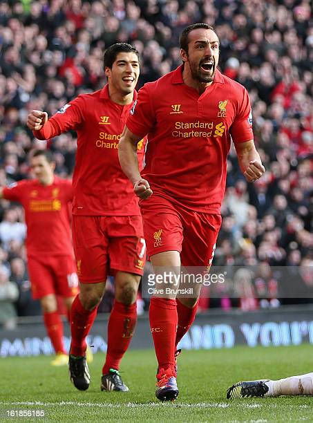 Jose Enrique of Liverpool celebrates with Luis Suarez after scoring the third goal during the Barclays Premier League match between Liverpool and...