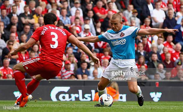Jose Enrique of Liverpool closes down Lee Cattermole of Sunderland during the Barclays Premier League match between Liverpool and Sunderland at...