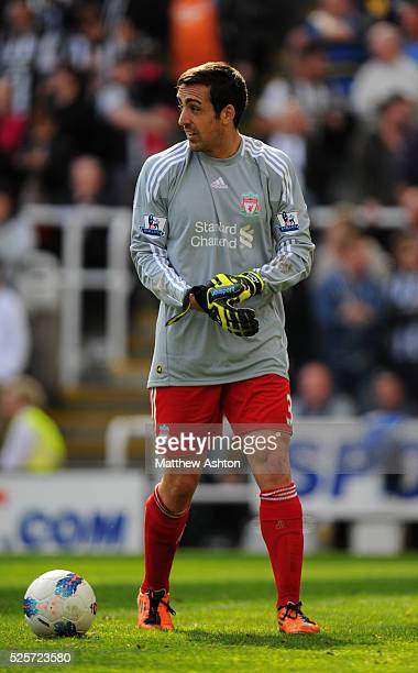 Jose Enrique of Liverpool goes in goal as goalkeeper after Jose Manuel Reina was sent off