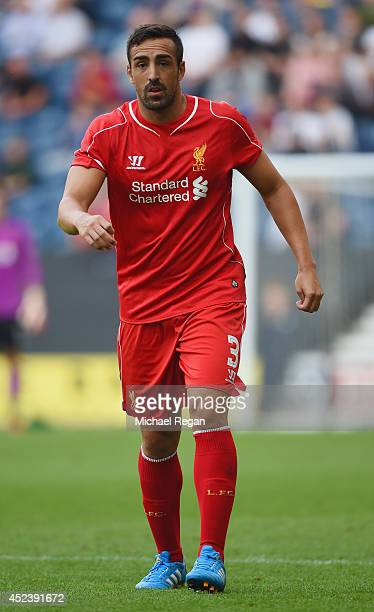 Jose Enrique of Liverpool in action during the pre season friendly match between Preston North End and Liverpool at Deepdale on July 19 2014 in...