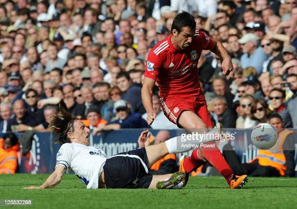 Jose Enrique of Liverpool in action with Luka Modric of Tottenham Hotspur during the Barclays Premier League match between Tottenham Hotspur and...
