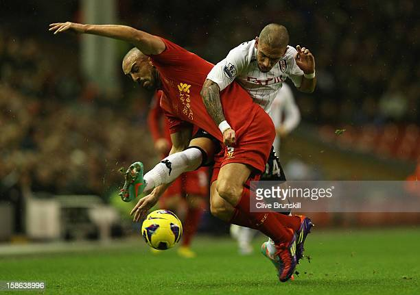 Jose Enrique of Liverpool tangles with Ashkan Dejagah of Fulham during the Barclays Premier League match between Liverpool and Fulham at Anfield on...