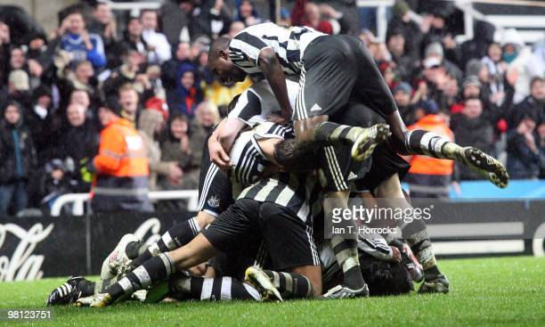 Jose Enrique of Newcastle United is mobbed after scoring the second goal during the Coca Cola Championship match between Newcastle United and...
