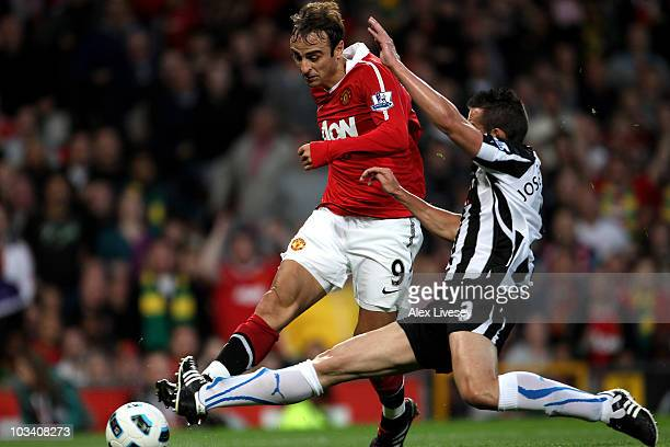 Jose Enrique of Newcastle United is unable to stop Dimitar Berbatov of Manchester United scoring the opening goal during the Barclays Premier League...