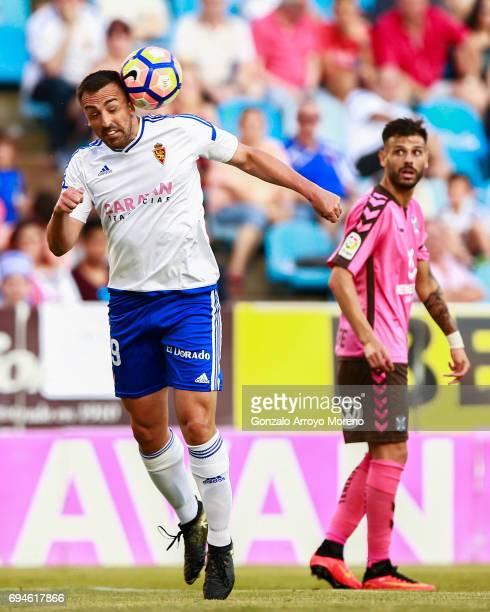 Jose Enrique of Real Zaragoza saves on a header during the La Liga 2 match between Real Zaragoza and CD Tenerife at La Romareda stadium on June 10,...