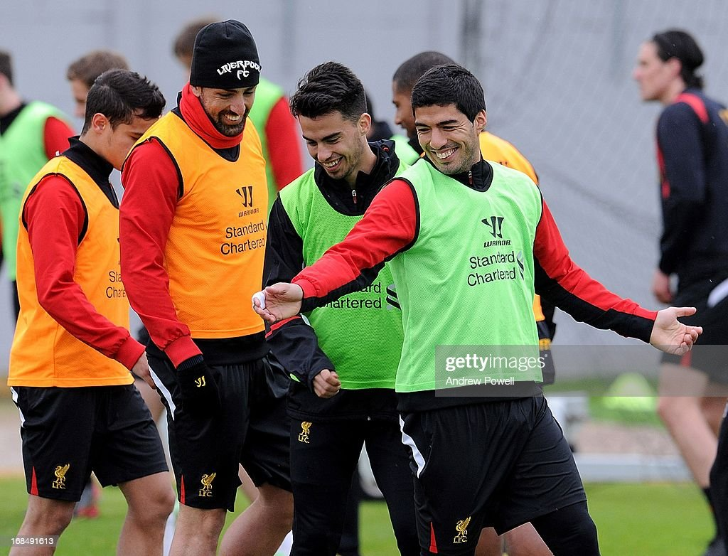 Jose Enrique, Suso and Luis Suarez of Liverpool laugh during a training session at Melwood Training Ground on May 10, 2013 in Liverpool, England.