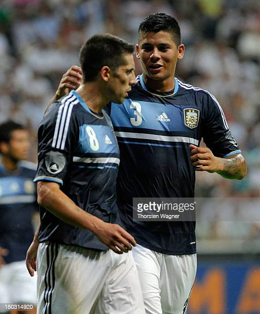 Jose Ernesto da Sosa and his team mate Faustino Marcos Alberto Rojo of Argentina celebrates after Sami Khedira is scoring the 1:0 with a own goal...