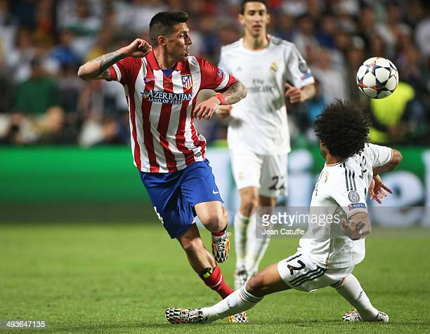 Jose Ernesto Sosa of Atletico Madrid is tackled by Marcelo Vieira da Silva of Real Madrid during the UEFA Champions League final between Real Madrid...