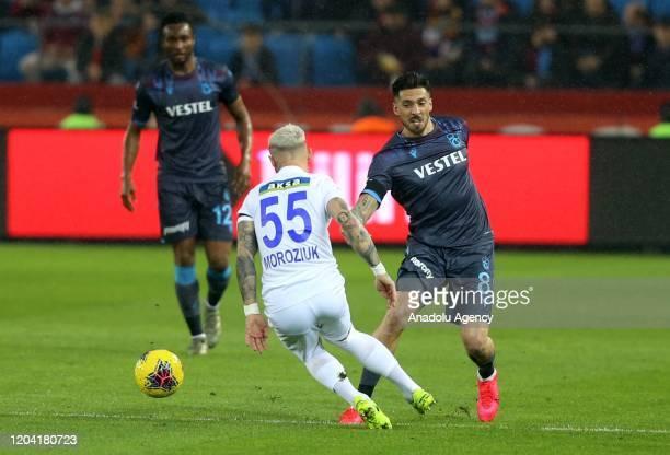 Jose Ernesto Sosa of Trabzonspor and Mykola Moroziuk of Caykur Rizespor vie for the ball during the Turkish Super Lig week 24 match between...