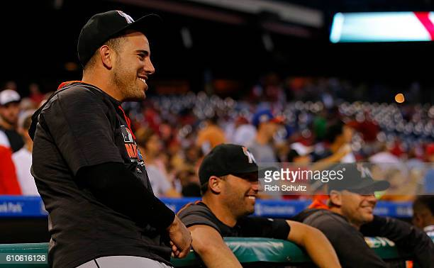 Jose Fernandez of the Miami Marlins laughs at the antics of the Phillie Phanatic before a game against the Philadelphia Phillies at Citizens Bank...