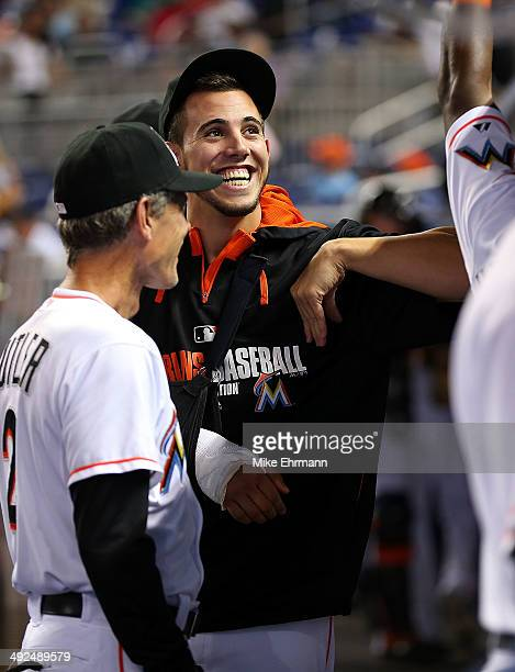 Jose Fernandez of the Miami Marlins looks on from the dugout after undergoing Tommy John surgery during a game against the Philadelphia Phillies at...