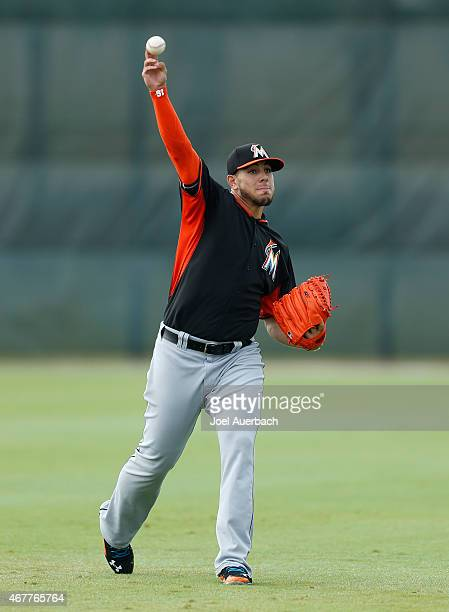 Jose Fernandez of the Miami Marlins throws on a back lot prior to the spring training game against the St. Louis Cardinals at Roger Dean Stadium on...
