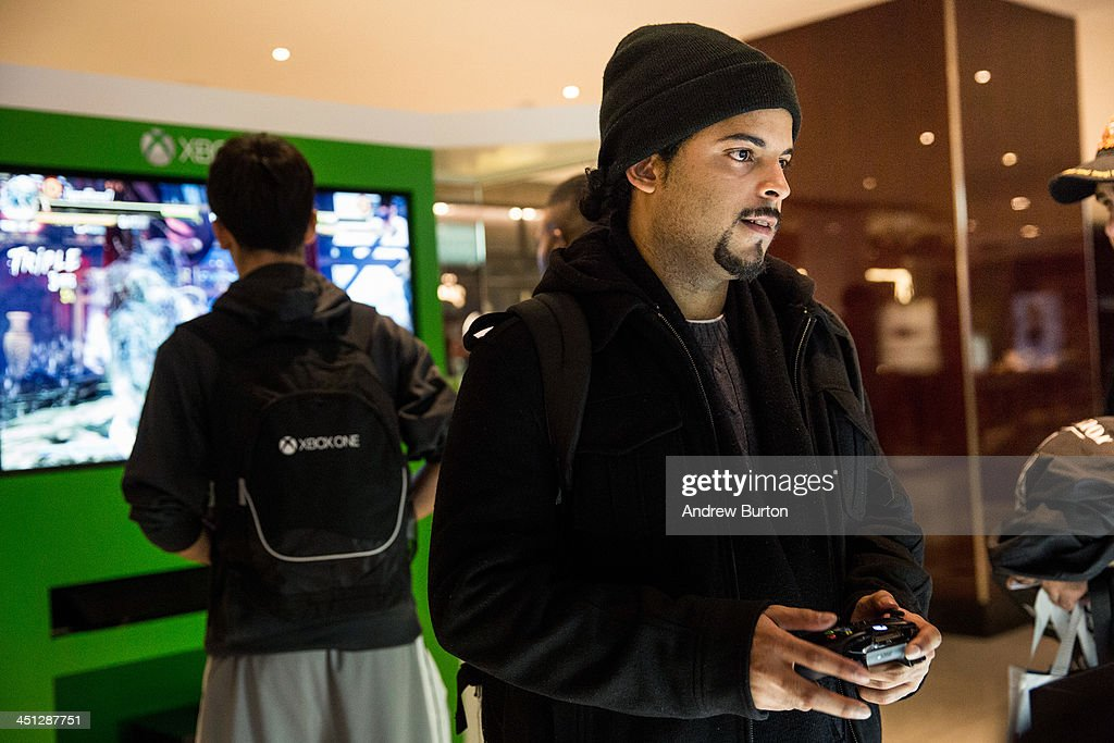 Jose Ferreira plays an XBox One - a new video game console and home entertainment system made by Microsoft- while waiting in line to buy an XBox One from a Microsoft 'pop-up shop' at the Time Warner Center at Columbus Circle on 22, 2013 in New York City. The X Box One arrives just in time for the holiday season, and will be competing against the Sony Playstation Four, which came out last week.
