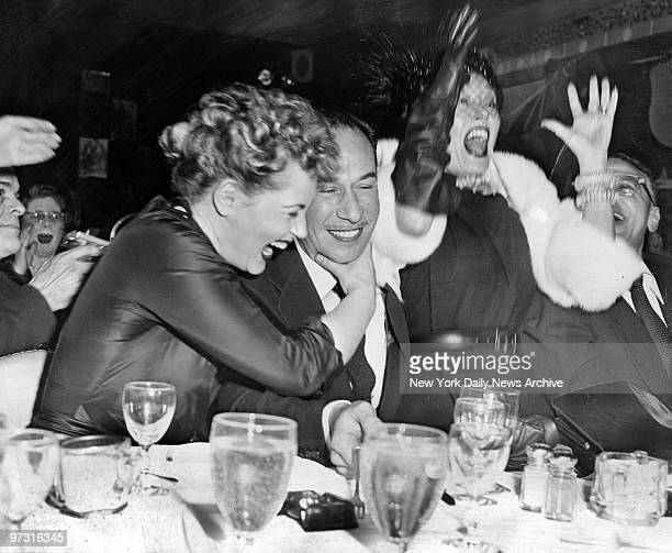 Jose Ferrer is hugged by Judy Holliday at LaZamba at 127 West 52d Street cafe immediately upon receipt of the news from Hollywood that Ferrer's...