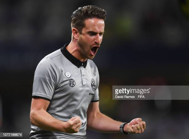 Jose Figueira manager of Team Wellington celebrates as Mario Ilich of Team Wellington scores his team's third goal during the FIFA Club World Cup...