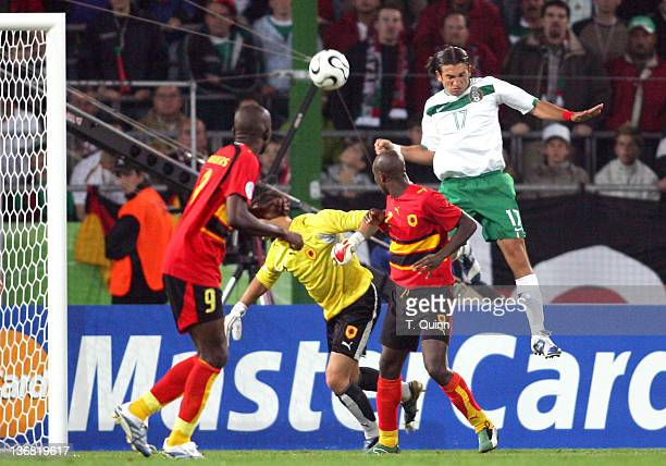 Jose Fonseca of Mexico heads the ball toward Angola's goal as the teams played to a 0-0 tie in a Group D game in FIFA World Cup Stadium, Hanover,...
