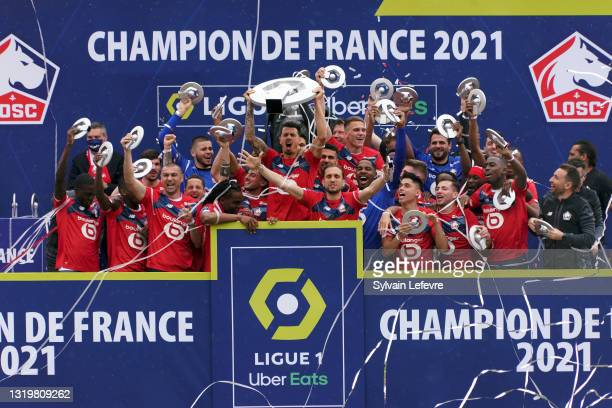 Jose Fonte and players of Lille OSC celebrate winning League 1 by receiving the trophy at their Luchin training center on May 24, 2021 in Lille,...