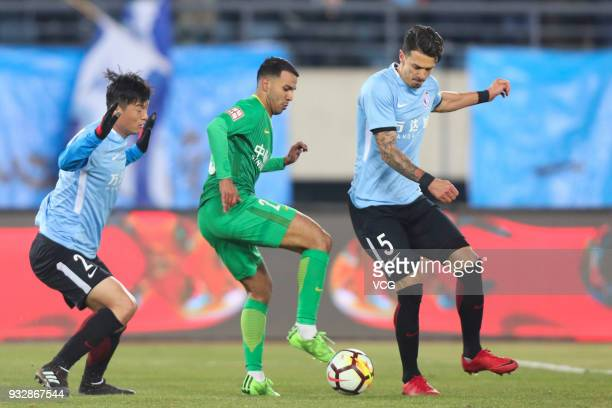 Jose Fonte of Dalian Yifang and Jonathan Viera of Beijing Guoan compete for the ball during the 2018 Chinese Football Association Super League third...