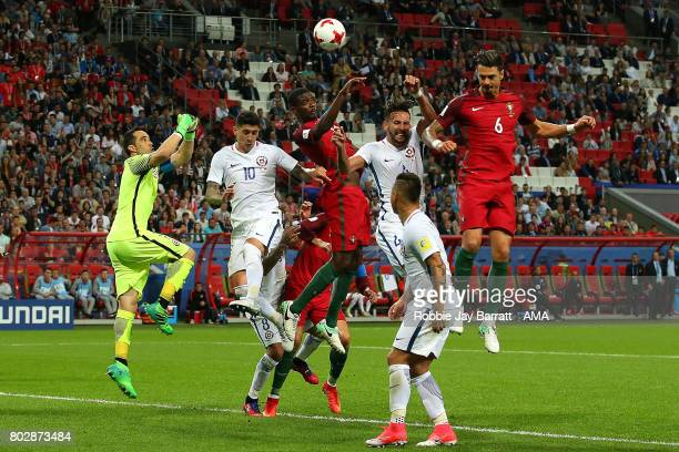 Jose Fonte of Portugal heads the ball at goal under pressure during the FIFA Confederations Cup Russia 2017 SemiFinal match between Portugal and...