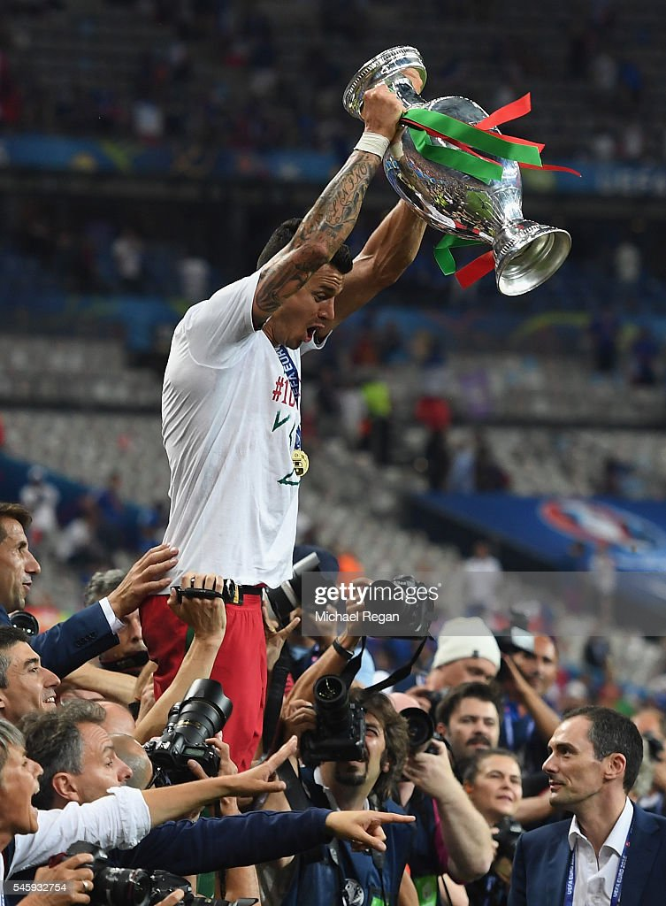 Jose Fonte of Portugal lifts the Henri Delaunay trophy to celebrate after his team's 1-0 win against France in the UEFA EURO 2016 Final match between Portugal and France at Stade de France on July 10, 2016 in Paris, France.