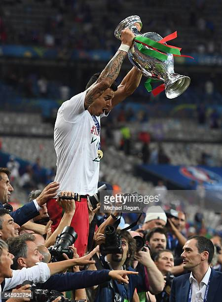 Jose Fonte of Portugal lifts the Henri Delaunay trophy to celebrate after his team's 10 win against France in the UEFA EURO 2016 Final match between...