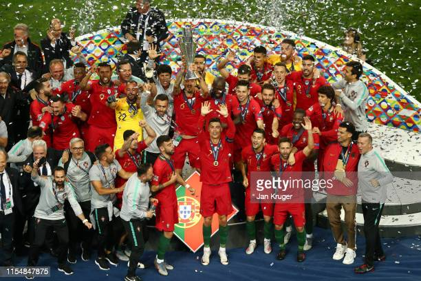 Jose Fonte of Portugal lifts the UEFA Nations League Trophy following their team's victory in the UEFA Nations League Final between Portugal and the...