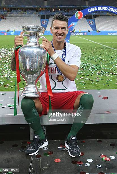 Jose Fonte of Portugal poses with the trophy following the UEFA Euro 2016 final match between Portugal and France at Stade de France on July 10 2016...