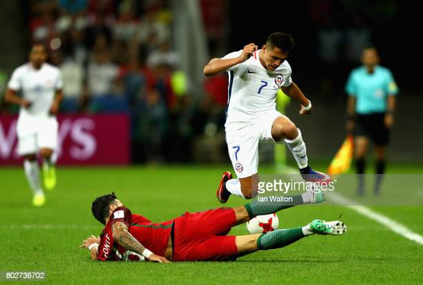 Jose Fonte of Portugal tackles Alexis Sanchez of Chile during the FIFA Confederations Cup Russia 2017 SemiFinal between Portugal and Chile at Kazan...