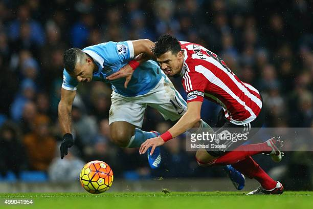 Jose Fonte of Southampton and Sergio Aguero of Manchester City compete for the ball during the Barclays Premier League match between Manchester City...