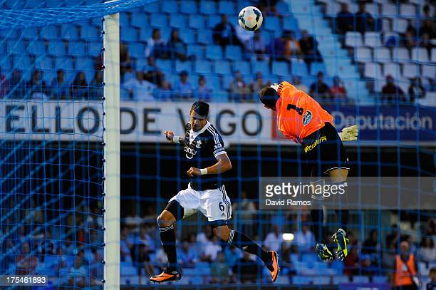 Jose Fonte of Southampton duels for a high ball with Sergio Alvarez of RC Celta de Vigo during a friendly match between RC Celta de Vigo and...