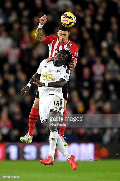 Jose Fonte of Southampton rises above Bafetibis Gomis of Swansea City to win a header during the Barclays Premier League match between Southampton...