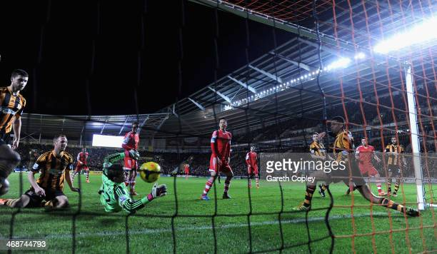 Jose Fonte of Southampton scores past Hull City goalkeeper Stephen Harper during the Premier League between Hull City and Southampton at KC Stadium...