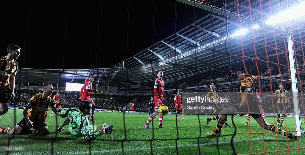 Jose Fonte of Southampton scores past Hull City goalkeeper Stephen Harper during the Premier League between Hull City and Southampton at KC Stadium on February 11, 2014 in Hull, England.