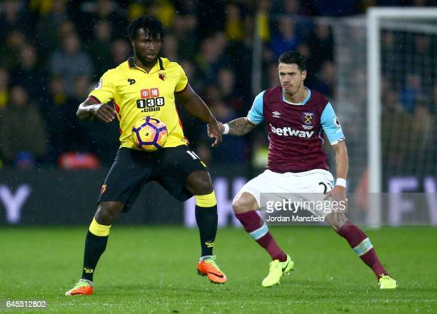 Jose Fonte of West Ham United closes down Isaac Success of Watford during the Premier League match between Watford and West Ham United at Vicarage...