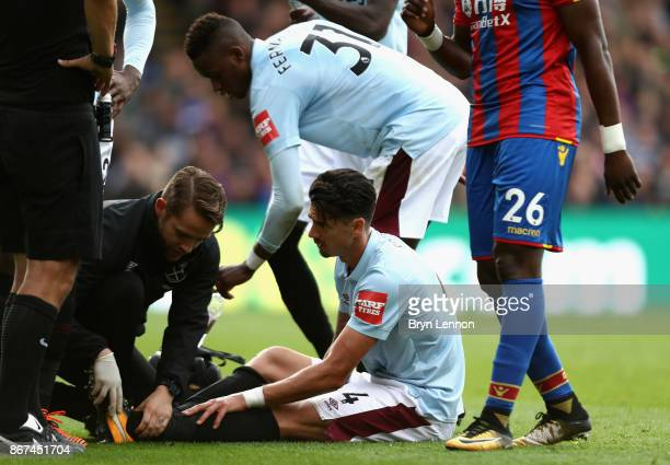 Jose Fonte of West Ham United receives treatment from the medical team during the Premier League match between Crystal Palace and West Ham United at...
