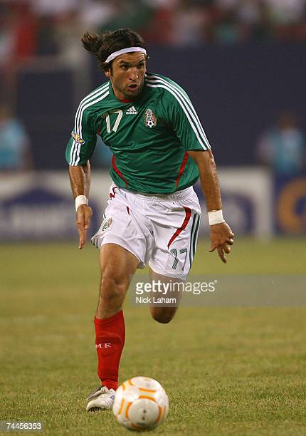 Jose Francisco Fonseca of Mexico dribbles the ball against Cuba during their first round match of the CONCACAF Gold Cup 2007 tournament on June 8,...