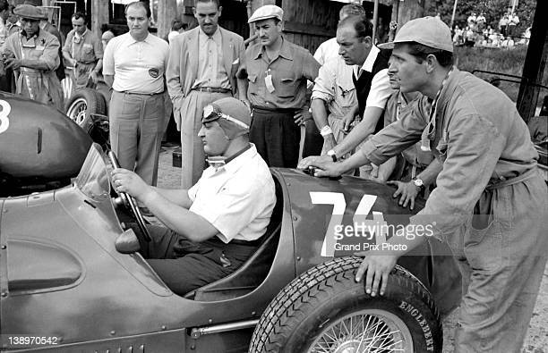 Jose Froilan Gonzalez of Argentina sits aboard the Scuderia Ferrari 375 Ferrari V12 in the pits during practice for the German Grand Prix on 28th...