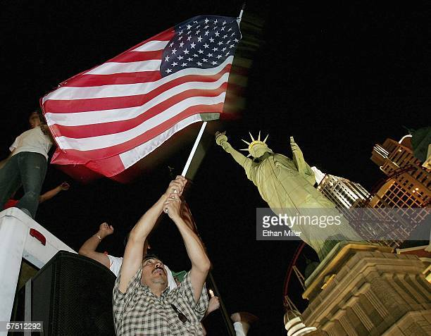 Jose Galvan of Nevada waves an American and Mexican flag in front of the halfsize replica of the Statue of Liberty at the New YorkNew York Hotel...