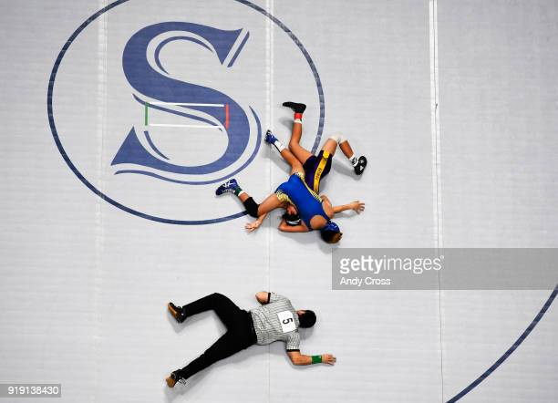 Jose Garcia middle Dolores Huerta wrestles Fernando Salazar top Fowler in a class 2A 113lb second round consolation match on the second day of the...