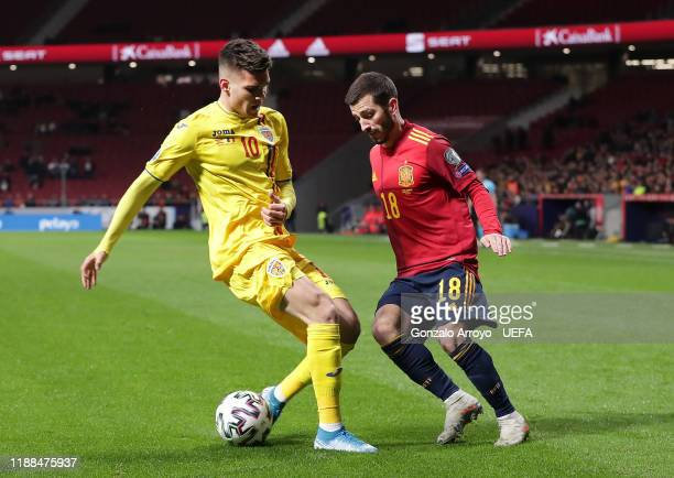 Jose Gaya of Spain battles for possession with Ianis Hagi of Romania during the UEFA Euro 2020 Qualifier between Spain and Romania on November 18...