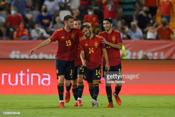 Jose Gaya of Spain celebrates with Aymeric Laporte and Carlos Soler but the goal is disallowed by VAR for offside during the 2022 FIFA World Cup...