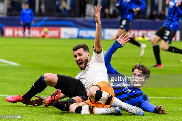 Jose Gaya of Valencia CF battles for the ball with Hans Hateboer of Atalanta during the UEFA Champions League round of 16 first leg match between...
