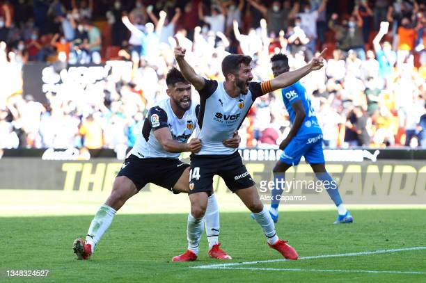 Jose Gaya of Valencia CF celebrates with his teammate Omar Alderete after scoring their team's second goal during the La Liga Santander match between...